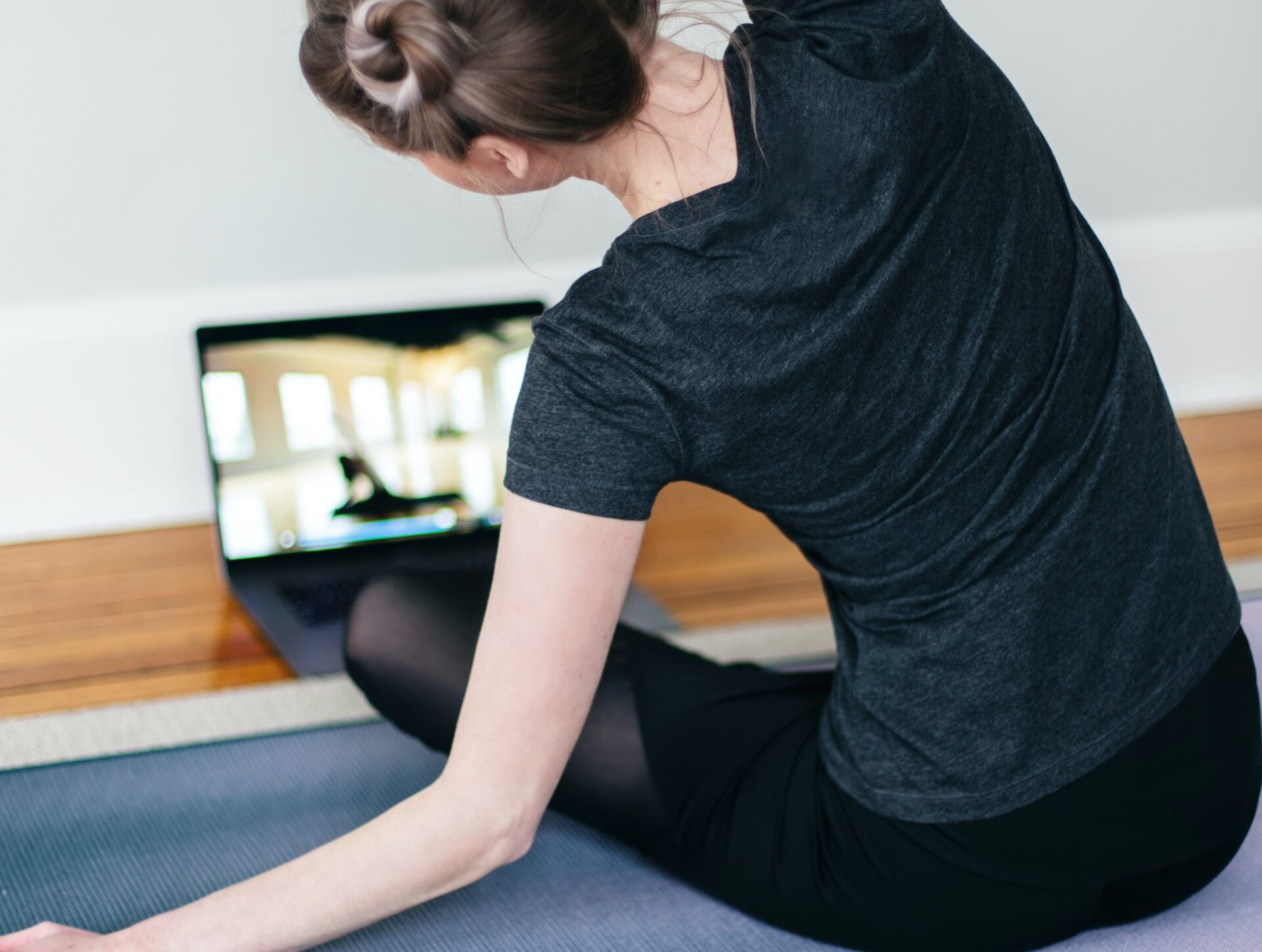 home workout via zoom - girl and her laptop
