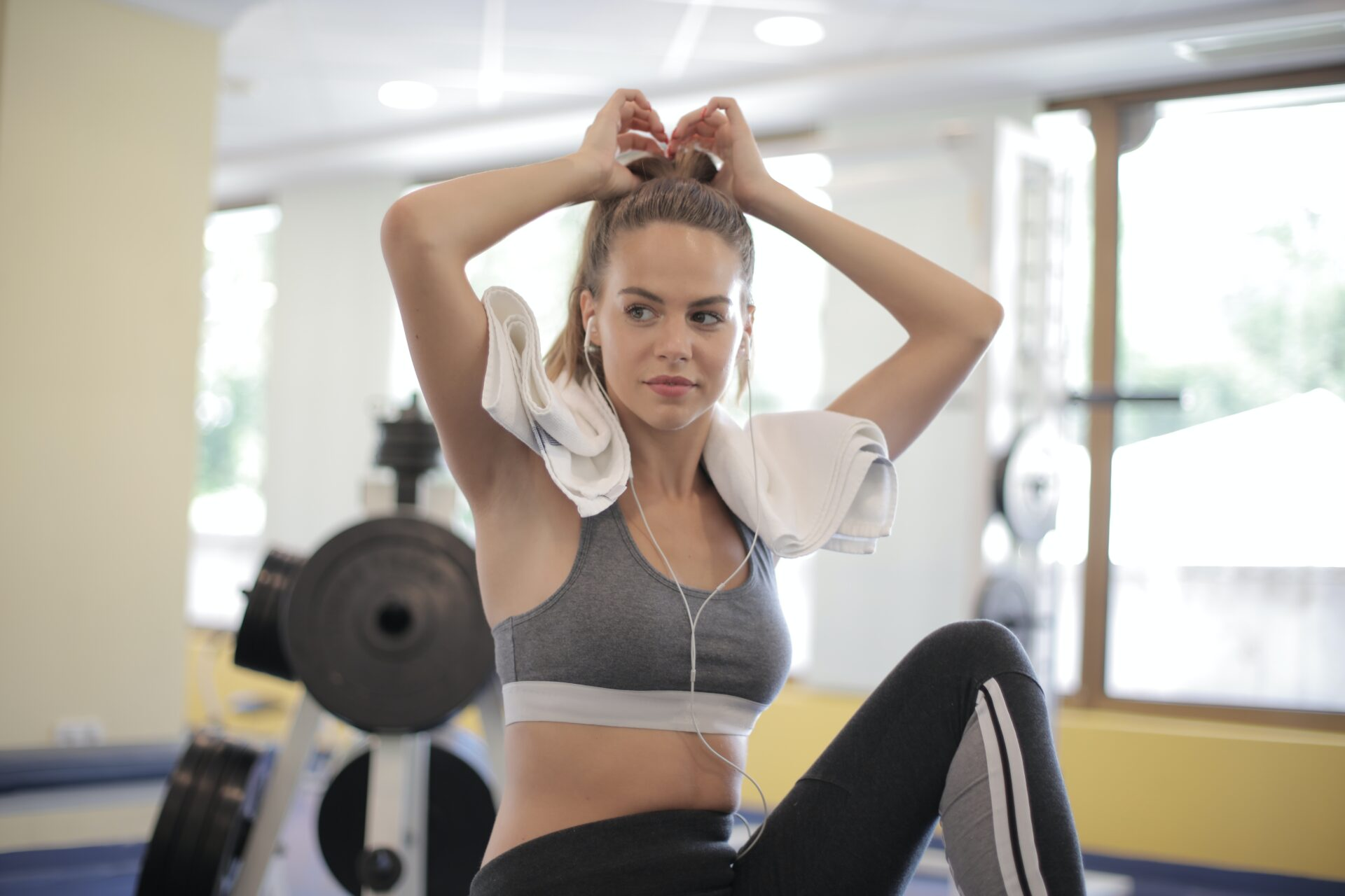 Strong Woman In Sportswear Preparing Practicing Fitness