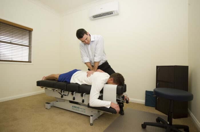 Michale Griffiths, treating a patient, Northern Inland Chiropractic