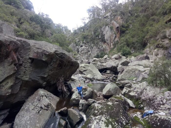 Alice Bakers Creek, UNE Outdoor Adventure Club, woman sitting on a rock