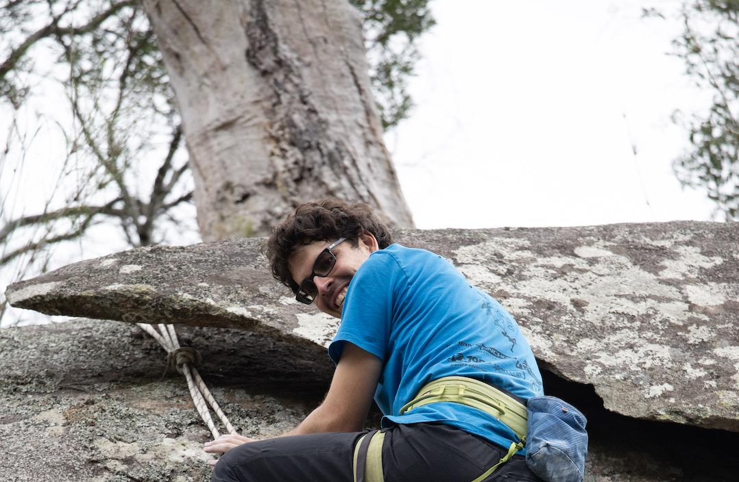 Andrew from SportUNEs Outdoor Adventure Club, rock climbing