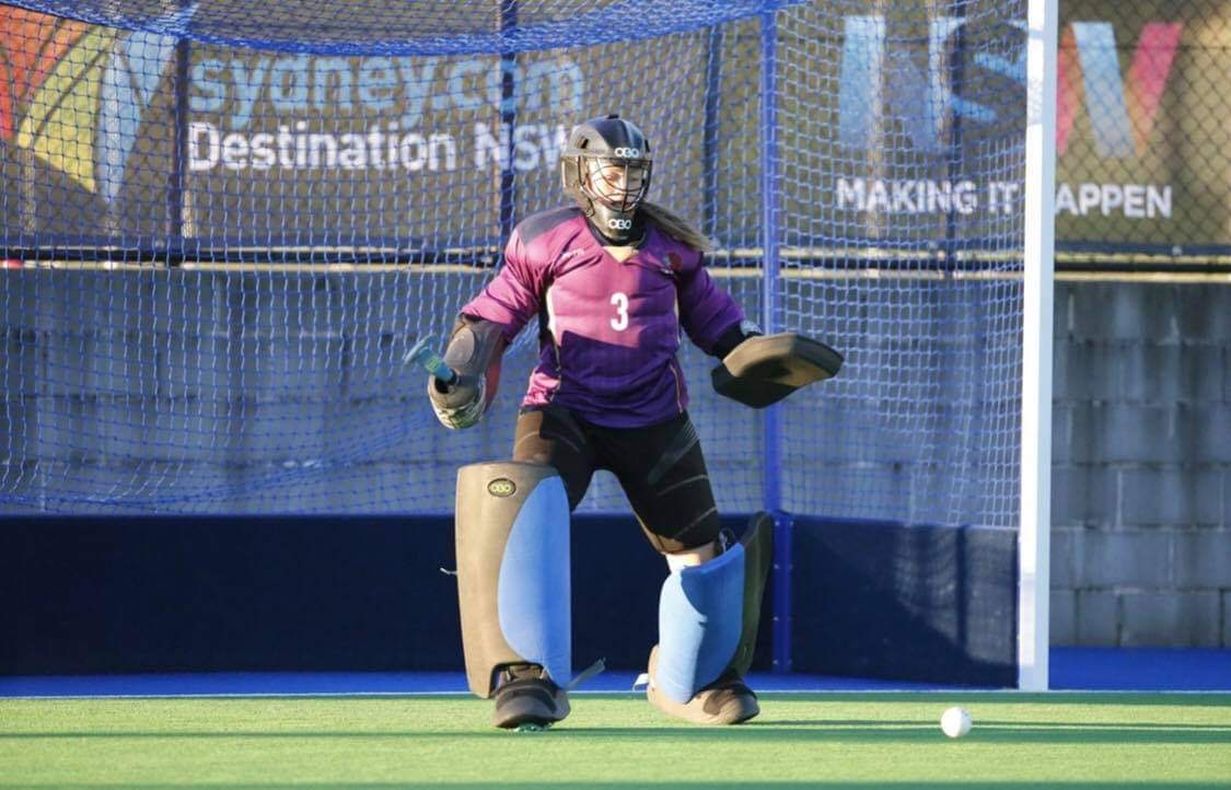 Chelsea Thornton UNE Sports Academy Student, in a hockey goal defending