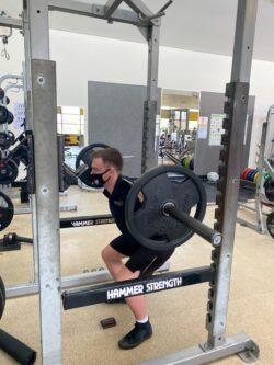 SportUNE staff member Justin on the squat rack