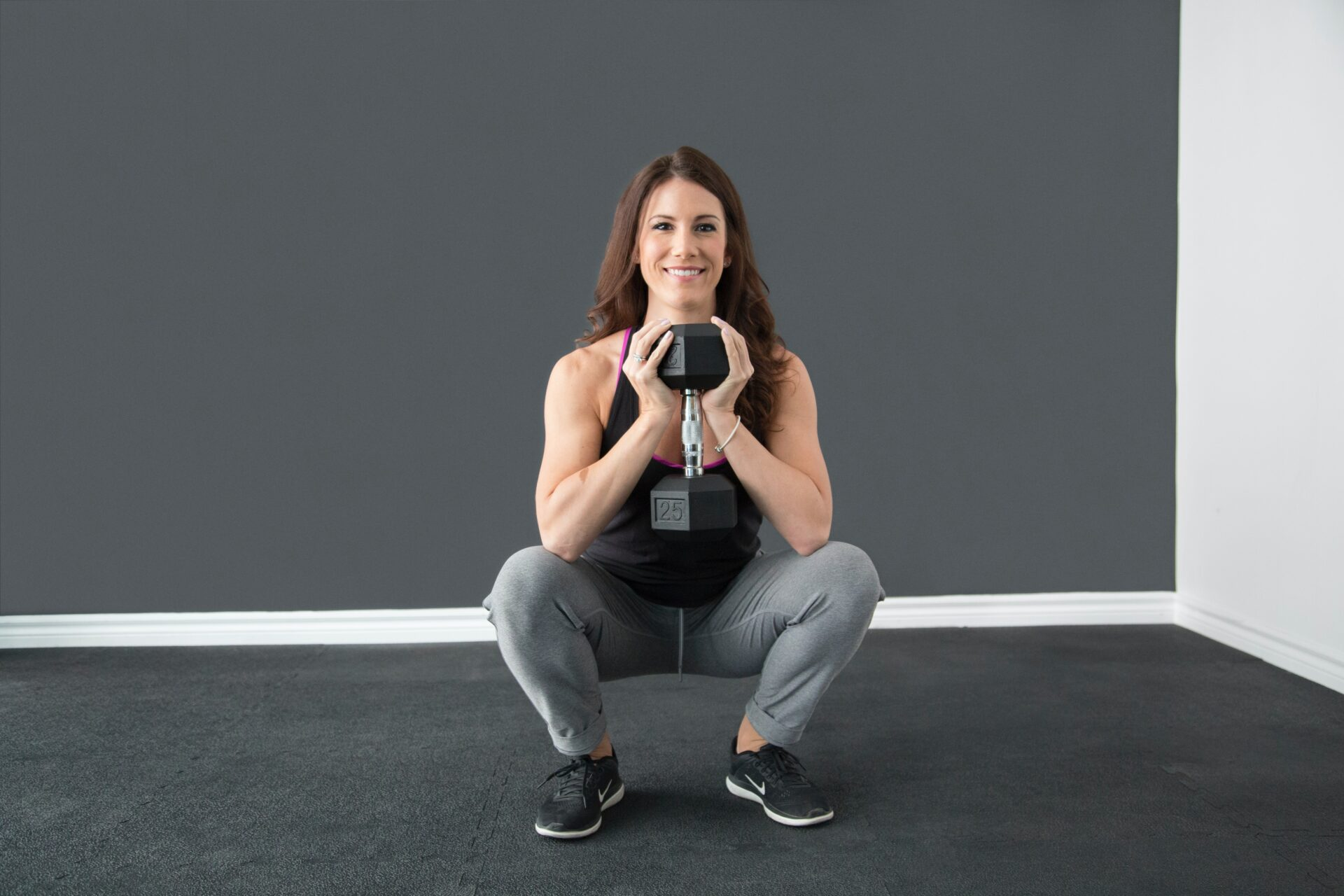 lady doing a deep squat with a weight